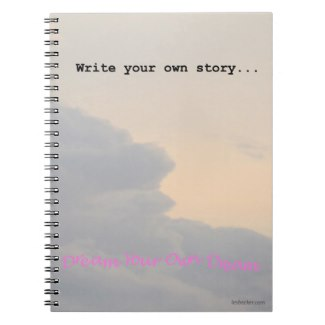 Spiral notebook with clouds against an overcast sky with the words write your own story at the top and Dream your dreams at the bottom